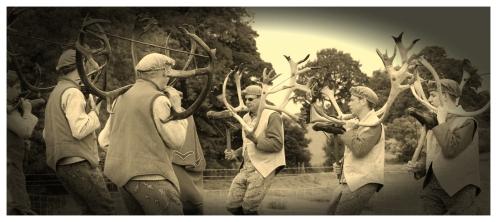 of horns, in homage, dance